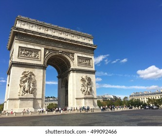 PARIS, FRANCE - AUGUST 28, 2016 : street view of the Triumphal Arch at the top of the Champs Elysees street