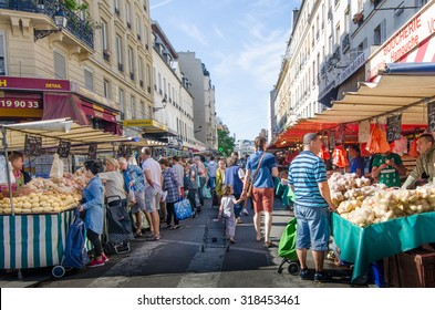 PARIS, FRANCE - AUGUST 29, 2015: The open-air market in the Bastille district is one of the largest and busiest in the city selling fresh produce from France and other European countries.