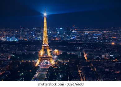 PARIS, FRANCE - AUGUST 29 2015: Night scene of illuminated Eiffel Tower and panoramic aerial view of Paris, France