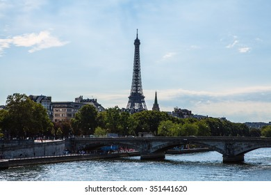 PARIS, FRANCE - AUGUST 30, 2015: Aerial view from bridge on Siena to Eiffel tower in Paris against twilight sky at evening summer time. Paris - August.