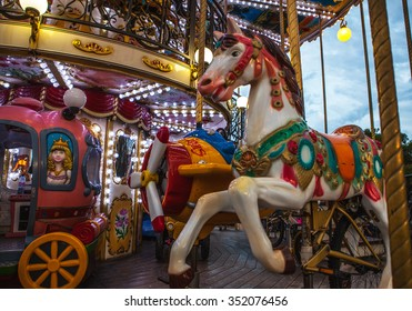 PARIS, FRANCE - AUGUST 30, 2015: Old French carousel in a holiday park at night summer time.