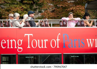 PARIS, FRANCE - AUGUST 31, 2006: Tourists on double decker bus at roundtrip in Paris, France.