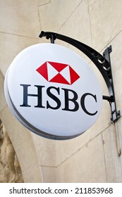 PARIS, FRANCE - AUGUST 4TH 2014: The sign for the 'HSBC' bank on Avenue des Champs-Elysees in Paris on 4th August 2014.  Founded in 1865, HSBC is currently the world's second largest bank company.