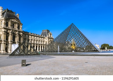 PARIS, FRANCE - AUGUST 5, 2018: in this photo a view on the Louvre Museum built as the Louvre castle in the late 12th to 13th century. In the foreground The Pyramid were inaugurated in 1988.