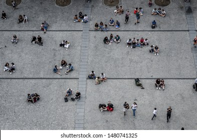 PARIS, FRANCE - August 7, 2019 : People sitting and walking on a square in Paris