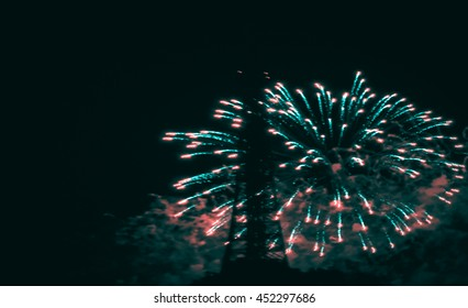 Paris, France. Blurred toned photo of fireworks near Eiffel Tower during celebrations of French national holiday (Bastille Day, on 14 July).