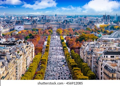 Paris, France - Champs Elysees cityscape. View from Arc de Triomphe. Blue sky with clouds in autumn