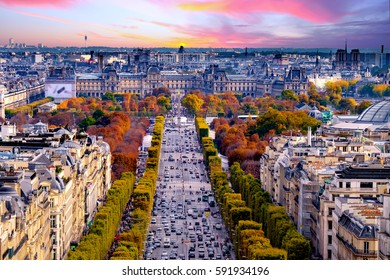 Paris, France - Champs Elysees cityscape. View from Arc de Triomphe. Dramatic sunset sky with clouds in autumn
