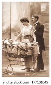 PARIS, FRANCE- CIRCA 1920: antique family portrait of mother, father and newborn baby. parenting. Mother's Day