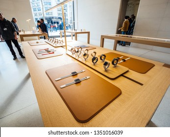 Paris, France - Circa 2019: Apple Watch Series 4 smart watches products wearable devices are displayed inside the new Apple Store Champs-Elysees people admiring the new technologies by Apple Computers