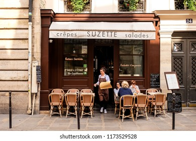 Paris, France - Circa April 2017 - A busy cafe in the afternoon near the Marais district of Paris.