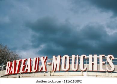 PARIS, FRANCE - CIRCA APRIL 2018: The station of Bateaux Mouches, the famous open excursion boats company that operates along the river Seine of Paris