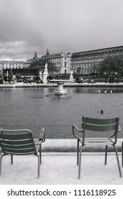 PARIS, FRANCE - CIRCA APRIL 2018: People sitting around a small pond in  Jardin des Tuileries, Paris