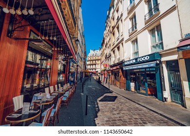Paris, France - circa May, 2017: Old cafes in the Quartier Latin with unidentified people in Paris. Quartier Latin is the traditional student area known for its student life