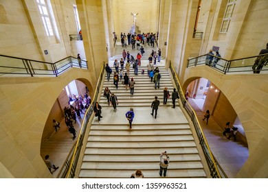 Paris, France - circa May, 2017: Interior of Louvre Museum Stairway in Denon with Winged Victory of Samothrace Ancient Sculpture stairs
