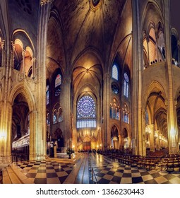 Paris, France - circa May, 2017: Wide panorama of interior hall of Notre Dame and the North Rose window at Notre Dame cathedral dates from 1250 and is also 12.9 meters in diameter