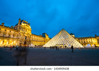 Paris, France- circa May, 2017: The Louvre is one of the most famous monuments and tourist attractions in Paris. Photo was taken during a warm spring evening after sunset