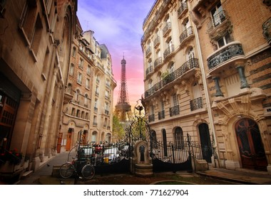 Paris, France – CIRCA October 2009: View on Eiffel Tower from courtyard in front of Art nouveau buildings