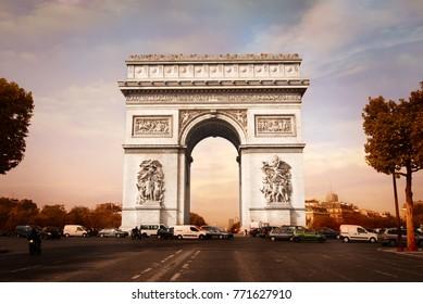 Paris, France – CIRCA October 2009: Cars pass by Triumphal arch in Champs-Élysées