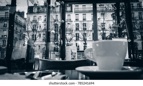 PARIS, FRANCE - DEC 12, 2014: Cafes in central Paris.  The French capital is famous for sidewalk cafes and brasseries.