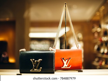 PARIS, FRANCE - DEC 23, 2017: Luxury Louis Vuitton handbag made from exclusive leather on sale during winter Christmas holidays in Paris, France and golden LV logo