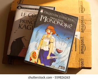 PARIS, FRANCE - DEC 28, 2016: Princess Mononoke and Tale of the Princess Kaguya DVD boxes and Amazon Prime cardboard box on table. Both anime movies are produced by Hayao Miyazaki, Studio Ghibli,