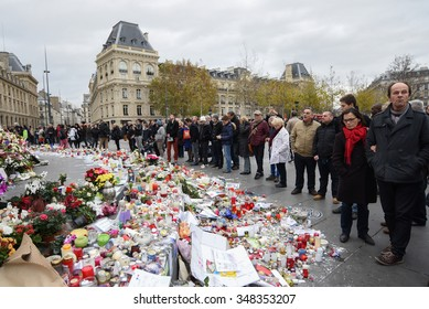 PARIS, FRANCE - DECEMBER 01, 2015: People paying tribute at the Place de la Republique to the victims of the terrorist attacks in Paris on November 13, 2015