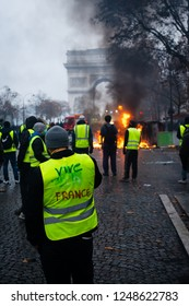 "Paris, France - December 01, 2018 : The Gilets Jaunes, or ""Yellow Vest"", protestors clash with police while demonstrating against the government of President Macron near the Arc de Triomphe."