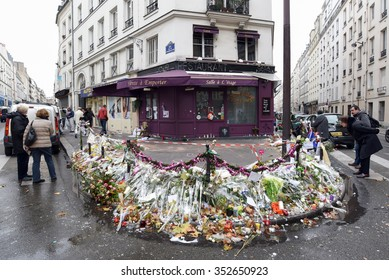 PARIS, FRANCE - DECEMBER 1, 2015: People paying tribute at the door of coffee Casa Nostra to the victims of the terrorist attacks in Paris on November 13, 2015.