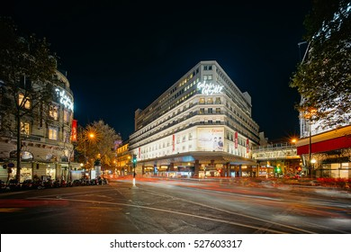 PARIS, FRANCE - DECEMBER 1, 2016: Night view of Galleries Lafayette and The Haussmann Boulevard. The Galeries Lafayette is an upmarket French department store chain.