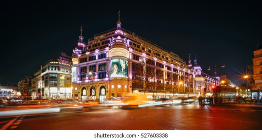 PARIS, FRANCE - DECEMBER 1, 2016: Night view of Le Printemps and the Haussmann Boulevard. Printemps is a French department store focusing on beauty, lifestyle, fashion, accessories, and men's wear.