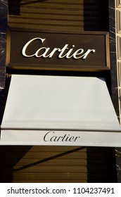 PARIS, FRANCE - DECEMBER 10, 2017: Cartier logo on their main shop on Champs Elysee avenue. Cartier is a French luxury goods company which designs and sells jewellery and watches