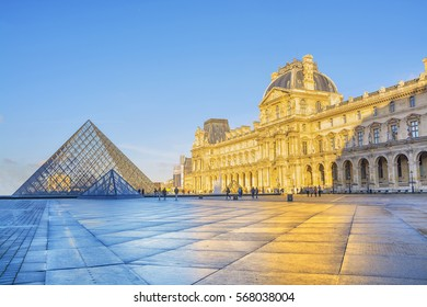PARIS, FRANCE - DECEMBER 10,2016: View of famous Louvre museum and glass Pyramid at morning. Louvre Museum is most visited museums worldwide and one of major tourist attractions of Paris.