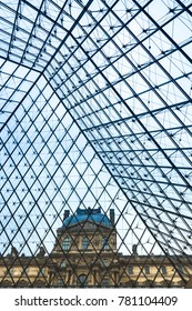 Paris, France - December 11, 2017: One of the Louvre museum's pavilions viewd from within theglas and metal pyramid.