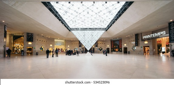 PARIS, FRANCE -  DECEMBER 12, 2016: Inverted pyramid in the shopping mall 'Carrousel du Louvre'. Louvre museum hosts one of the biggest art collection in the world.