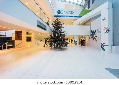 PARIS, FRANCE - DECEMBER 13, 2016: OECD(Organisation for Economic Co-operation and Development)interior with Christmas tree. The OECD is founded in 1961 to stimulate economic progress and world trade.
