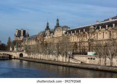 PARIS, FRANCE - DECEMBER 16, 2015: View of famous Louvre Museum from the Seine river. Louvre Museum is one of the largest and most visited museums worldwide.