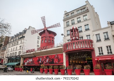 PARIS, FRANCE - DECEMBER 19, 2017: Moulin Rouge cabaret taken during a cloudy afternoon in Pigalle district, Moulin Rouge the most known cabarets of Paris, famous for creating cancan dance