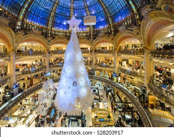 PARIS, FRANCE - DECEMBER 2, 2016: The Christmas tree under the dome of the Galeries Lafayette. The Galeries Lafayette has been selling luxury goods since 1895.