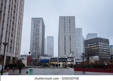 PARIS, FRANCE - DECEMBER 20, 2017: Olympiades square in the 13th arrondissement in Paris, in the Asian district, surrounded by skyscraper towers, during a grey rainy winter afternoon