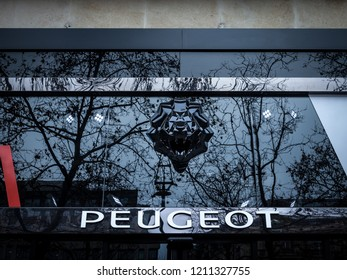 PARIS, FRANCE - DECEMBER 20, 2017: Peugeot logo on their showroom of Champs Elysees with its distinctive Lion. Peugeot, part of PSA group, is one of main french car producers