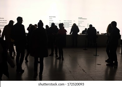 PARIS, FRANCE - DECEMBER, 2013: Visitors line up at the tickets to see the exhibition by Philippe Parreno in Palais de Tokyo, Paris.