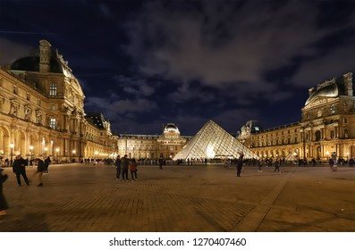 Paris, France - December 21, 2018: The Louvre Pyramid based in the main courtyard cour Napoleon of the Louvre Palace in Paris. It serves as the main entrance to the Louvre museum.