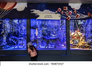 PARIS, FRANCE - DECEMBER 22, 2017: Christmas shop windows of Department Store Printemps (founded in 1865) in Paris, located boulevard Haussmann in Paris.
