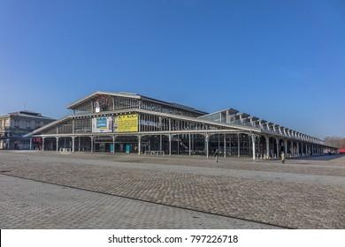 PARIS, FRANCE - DECEMBER 22, 2017: Grande halle de la Villette (1867) near Parc de la Villette. Grande halle de la Villette was formerly abattoir of La Villette and now a city's top cultural center.