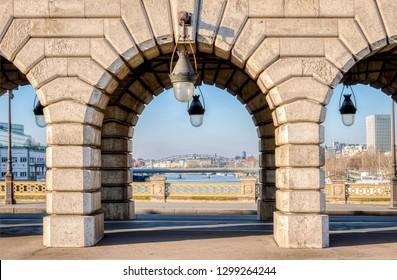 Paris, France - December 25, 2018: View of Austerlitz viaduct through an arch of Bercy bridge - Paris, France