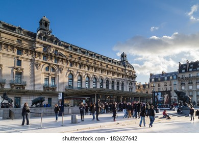 PARIS, FRANCE - DECEMBER 26, 2013: Tourists queuing outside the Orsay Museum waiting to enter