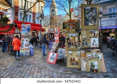 PARIS â?? FRANCE: DECEMBER 26, 2016. Bohemian painters painting in the Place du Tertre close of the Sacre Coeur of Montmartre in Paris.