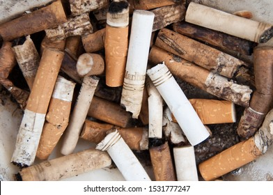 PARIS, FRANCE - DECEMBER 26: Close up of many different cigarettes butts, inclusing Marlboro cigarettes, on December 26, 2010 in Paris France