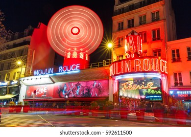 Paris, France - December 28, 2016: The picturesque famous cabaret Moulin Rouge located close to Montmartre in the Paris red-light district of Pigalle on boulevard Clichy at night, Paris, France.